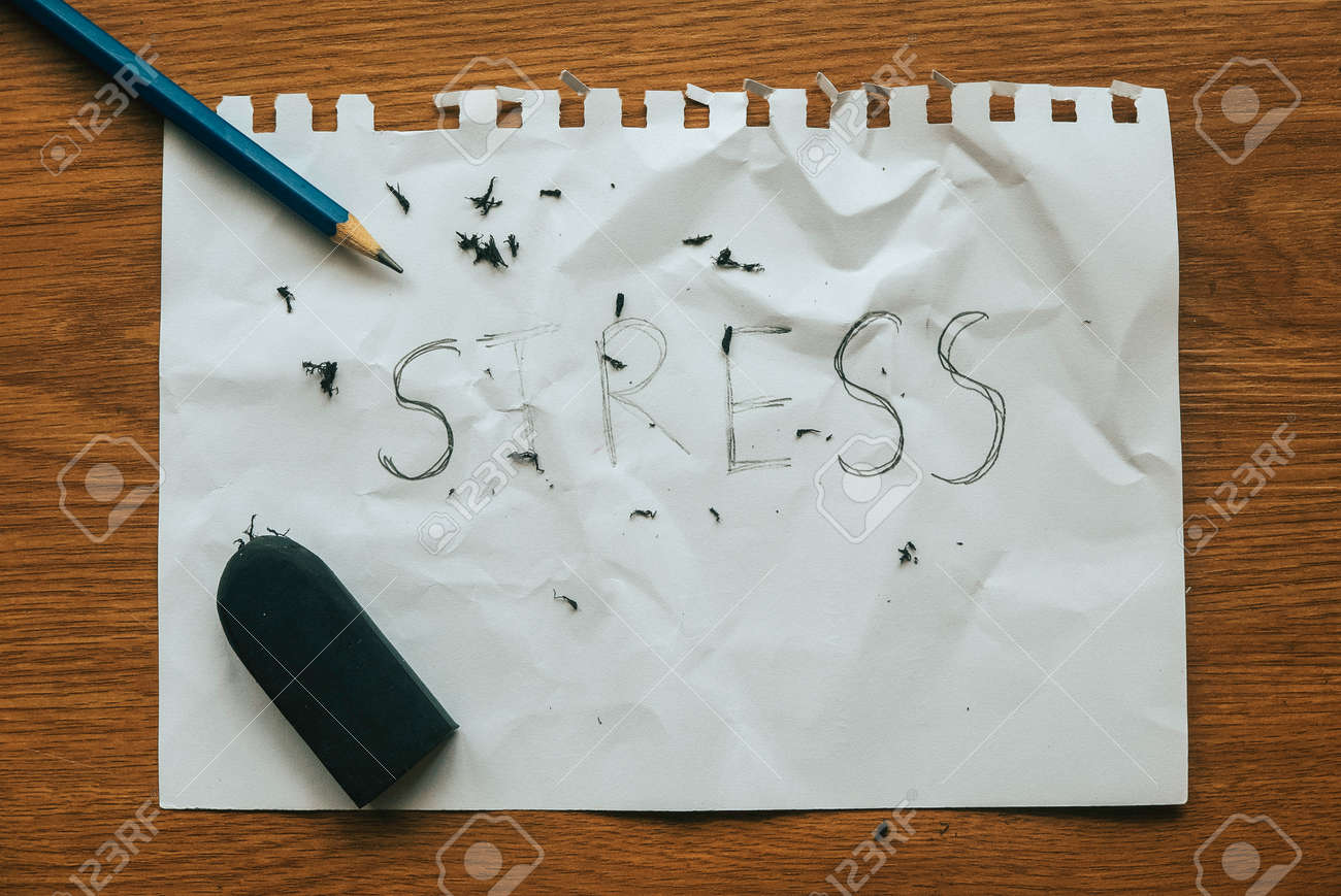 Stress relief and management concept.pencil with eraser strokes word stress on white paper. - 169596996