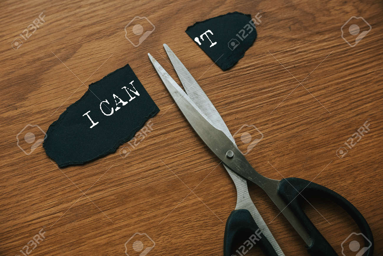 Motivational concept. Scissors cutting word I CAN'T to I CAN. - 169596999