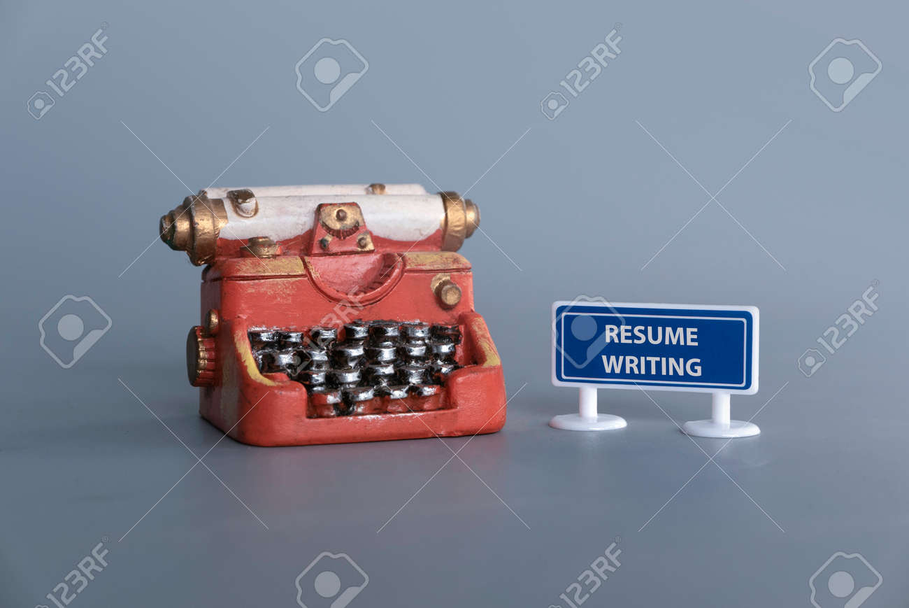 Miniature typewriter with signboard written with Resume Writing. - 169597043
