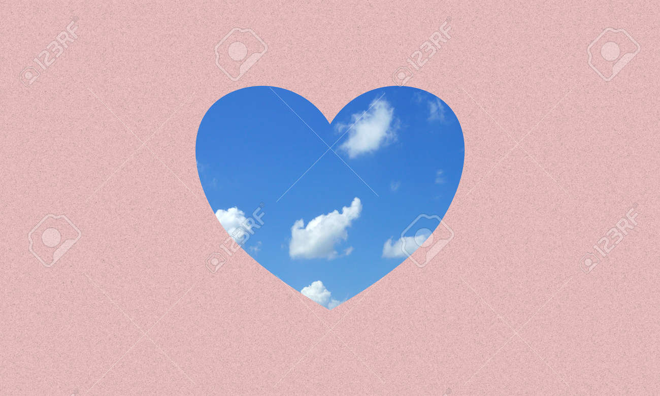 A love or heart icon fill with blue sky and clouds on pink paper background. - 169597208