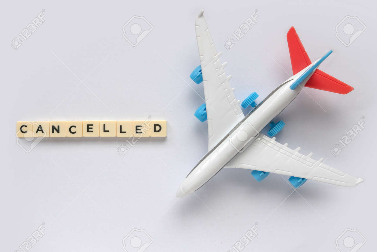 Top view of toy plane or flight with a text of cancelled. - 169597219