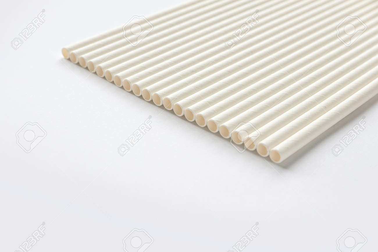 A row of biodegradable eco friendly white paper drinking straw isolated on white background - 169597224