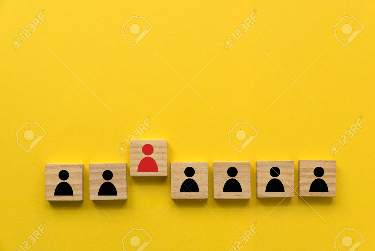 A row of wooden cube with people icon with one red people standing out from other. - 169597251