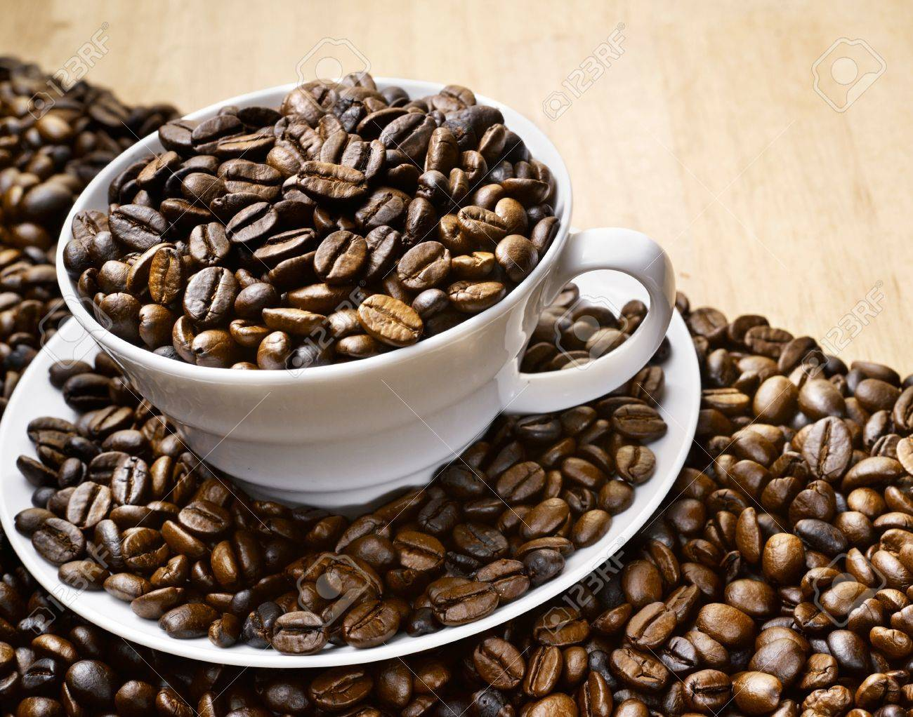 Close up coffee bean in a cup Stock Photo - 16254600