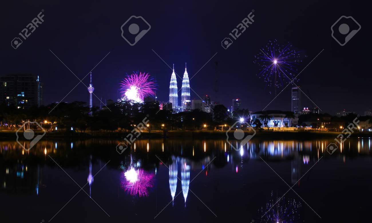 KUALA LUMPUR, MALAYSIA - JAN 1: A reflection of fireworks during the New Year 2011 celebrations near Malaysia landmark Petronas Twin Towers (KLCC) on January 1, 2011 in Kuala Lumpur Malaysia Stock Photo - 8526394