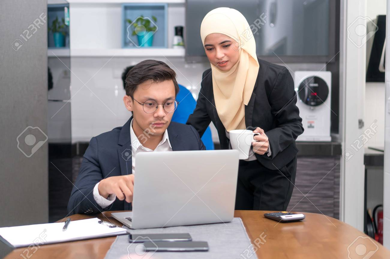 Asian malay executive working at home with laptop discussing - 109563131