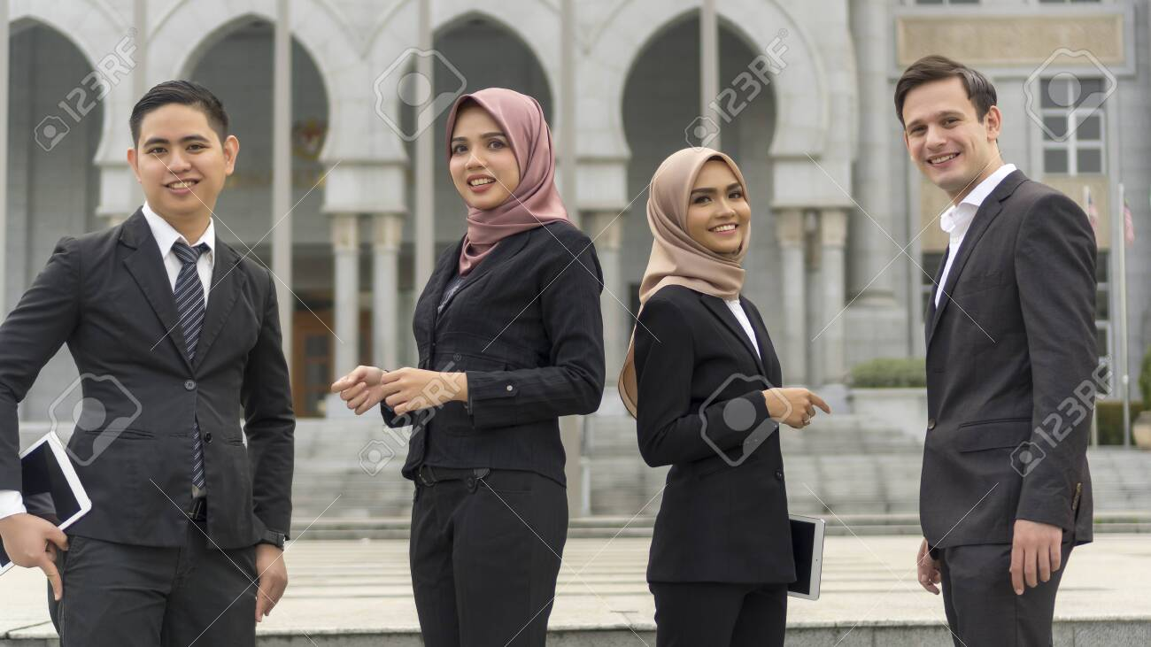A group of young mixed Asian Executive at the wearing suit standing and smile to camera - 136122431