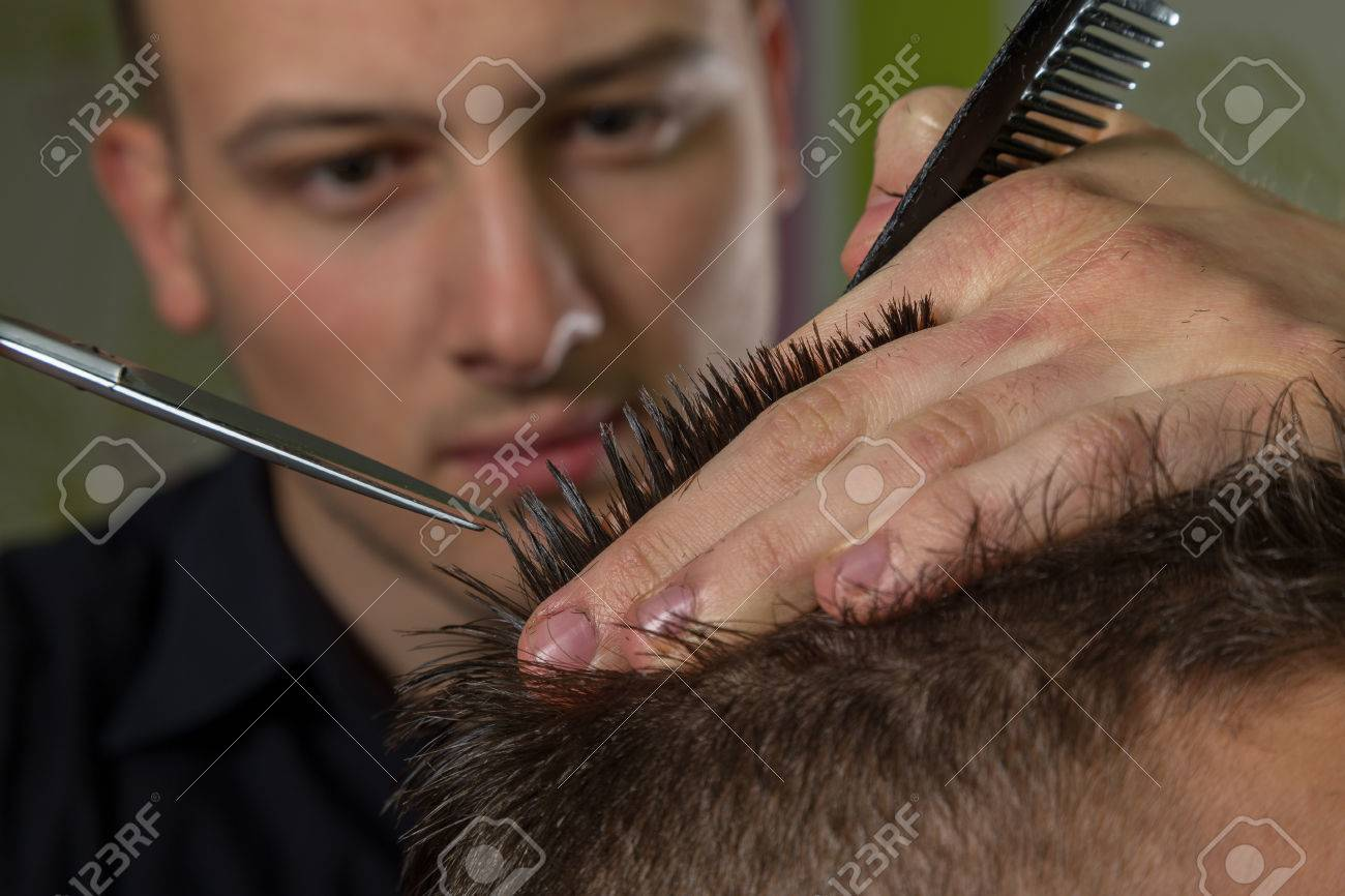 Men S Hair Cutting With Comb And Scissors In A Beauty Salon Stock