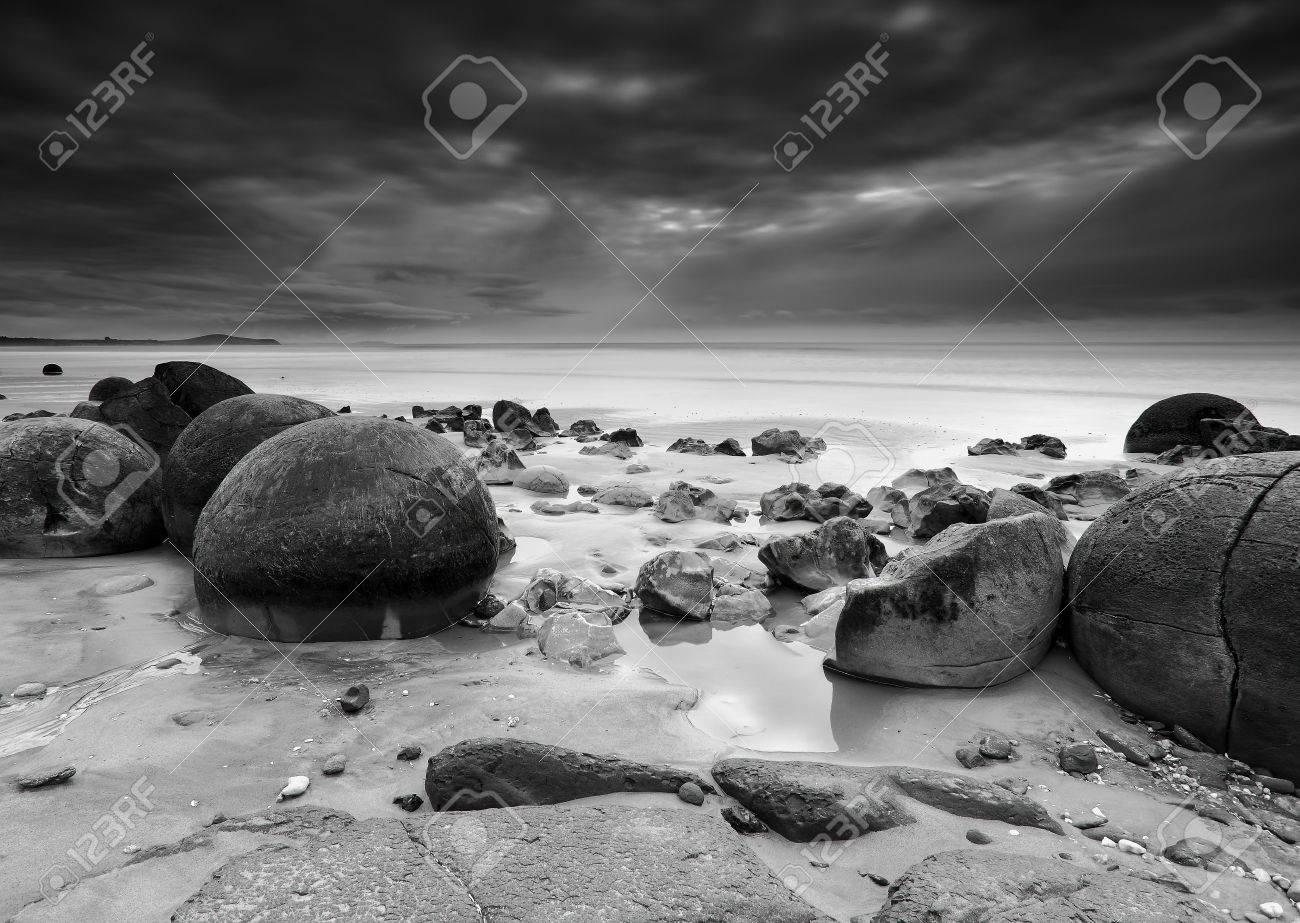 Moeraki boulders on dramatic black and white long exposure new zealand stock photo 23973943