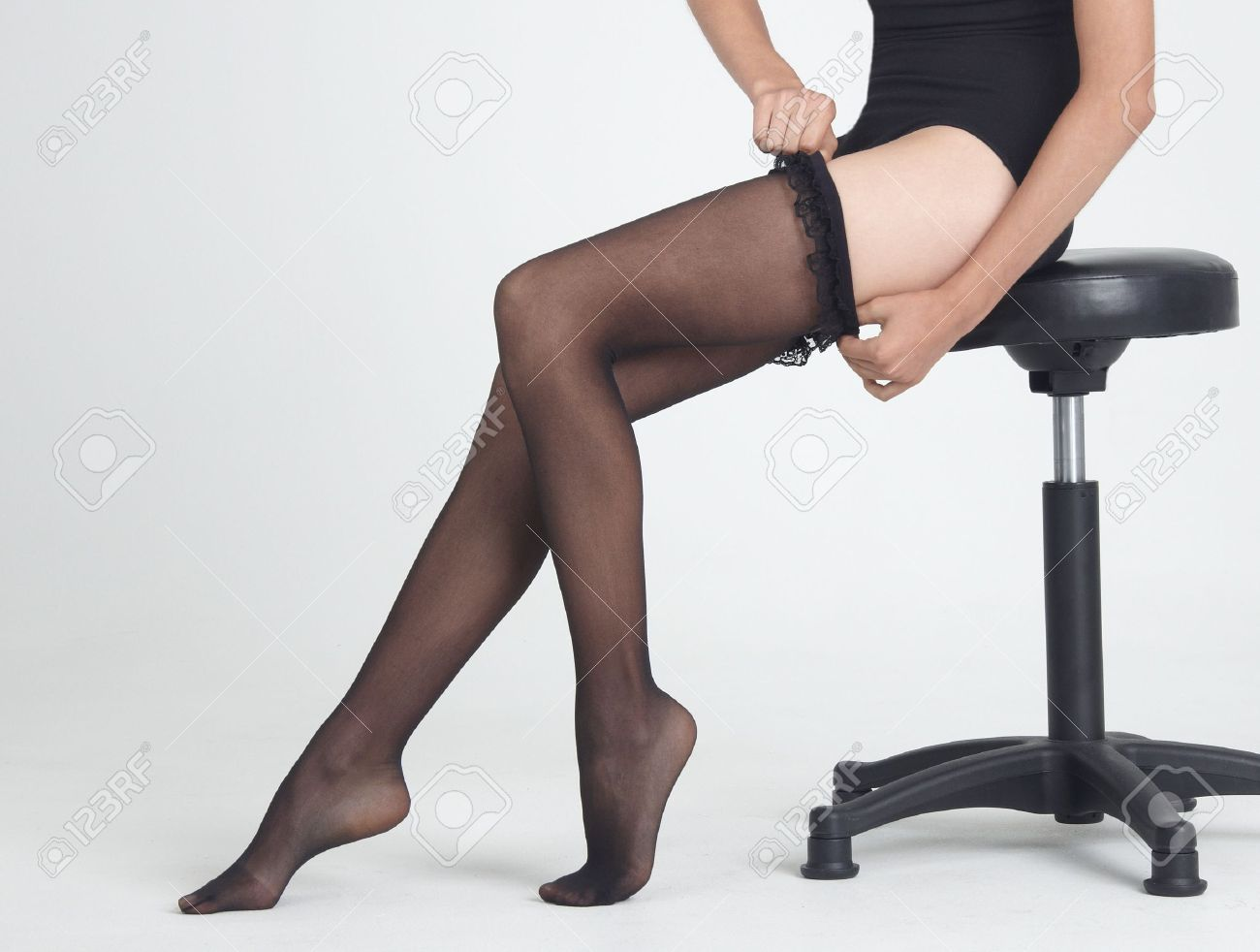 5097ec919319a Woman Putting On Black Stockings Stock Photo, Picture And Royalty ...