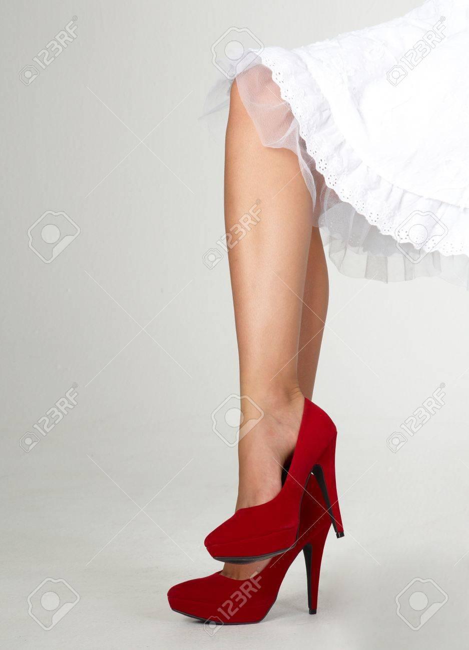 Woman s Crossed Legs Wearing Red High Heels Stock Photo - 15286506