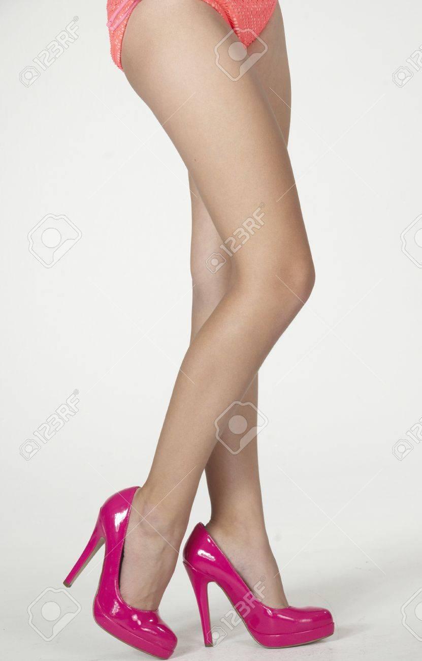 484c2761493 Woman S Legs In Pink High Heels And Bikini Bottom Stock Photo ...
