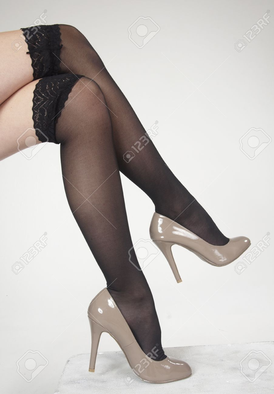 Close Up Of Woman S Legs Crossed Wearing High Heels Stock Photo ...