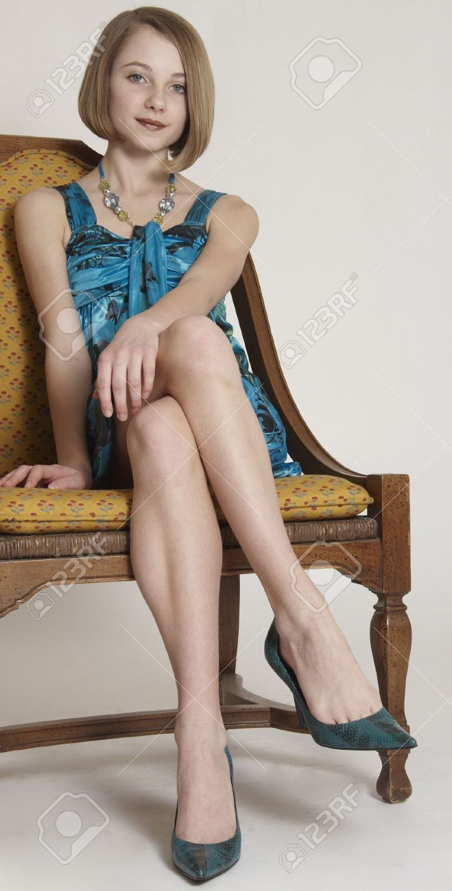 Pretty Teen Girl In A Short Skirt And Heels Sitting With Her ...