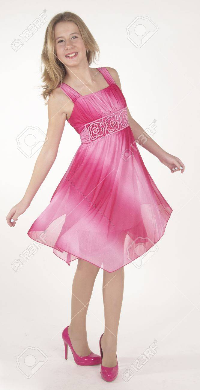 Teen Girl in a Pink Dress and Heels Stock Photo - 22168524