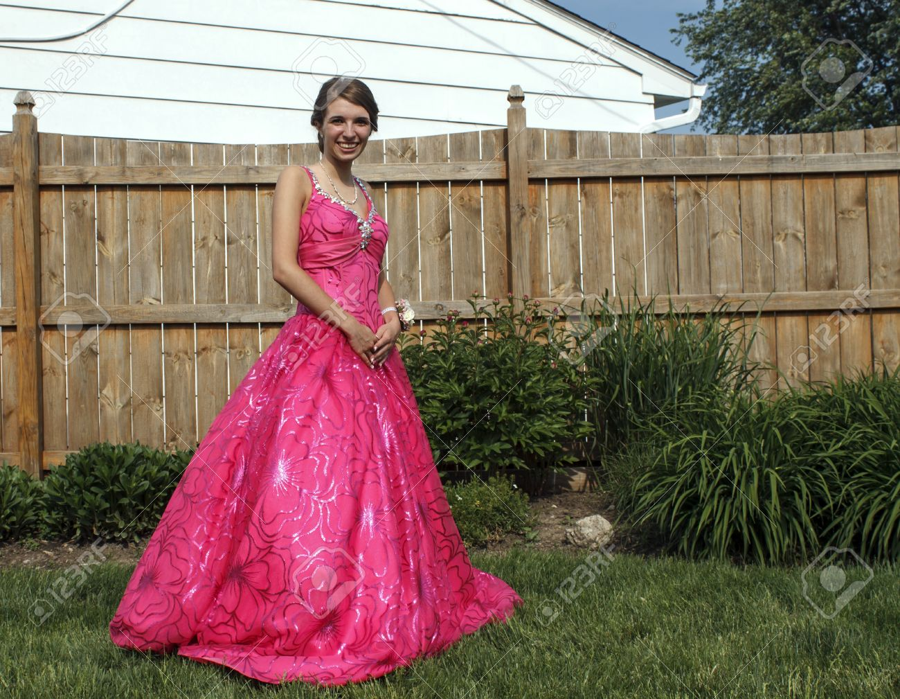 Girl Poses Outside In Her Beautiful Pink Prom Dress. Stock Photo ...