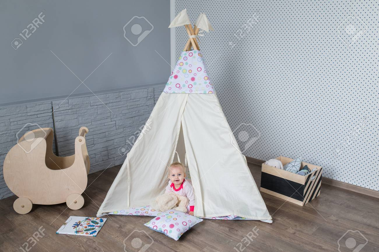 Child preschooler kids playing at home indoors with a teepee tent Stock Photo -  sc 1 st  123RF.com & Child Preschooler Kids Playing At Home Indoors With A Teepee ...
