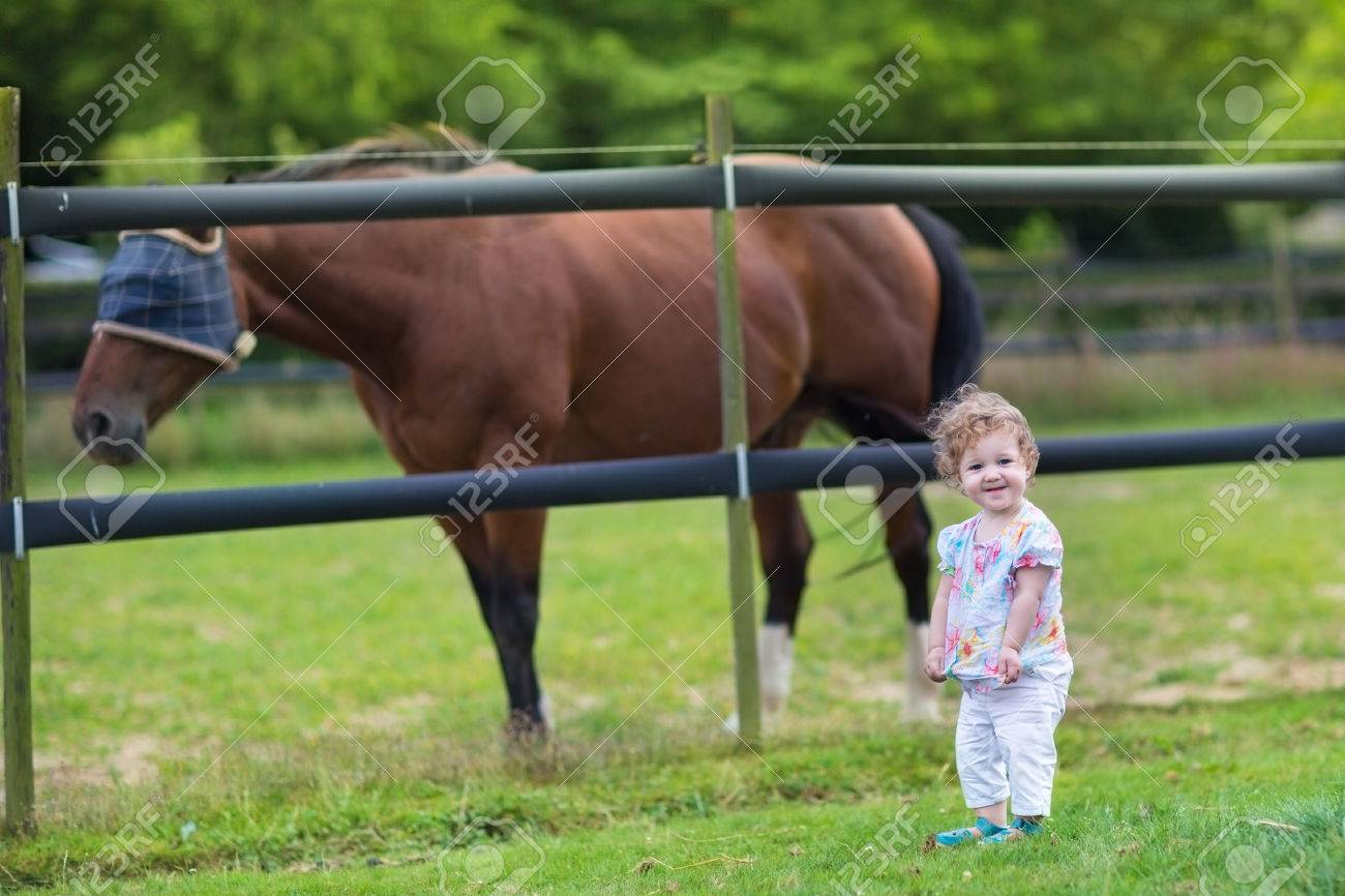 Cute Funny Baby Playing With A Horse On A Farm In Summer Stock Photo Picture And Royalty Free Image Image 29709176