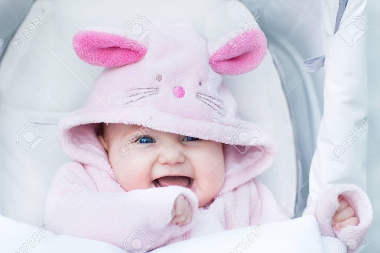 ecaf9da24fa1 Adorable Funny Baby Girl Sitting In A Stroller In A Bunny Snow ...