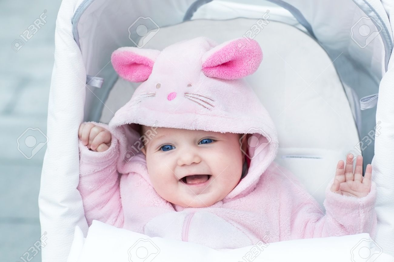 8488dcb77 Adorable Funny Baby Girl Wearing A Pink Warm Bunny Snow Suit.. Stock ...