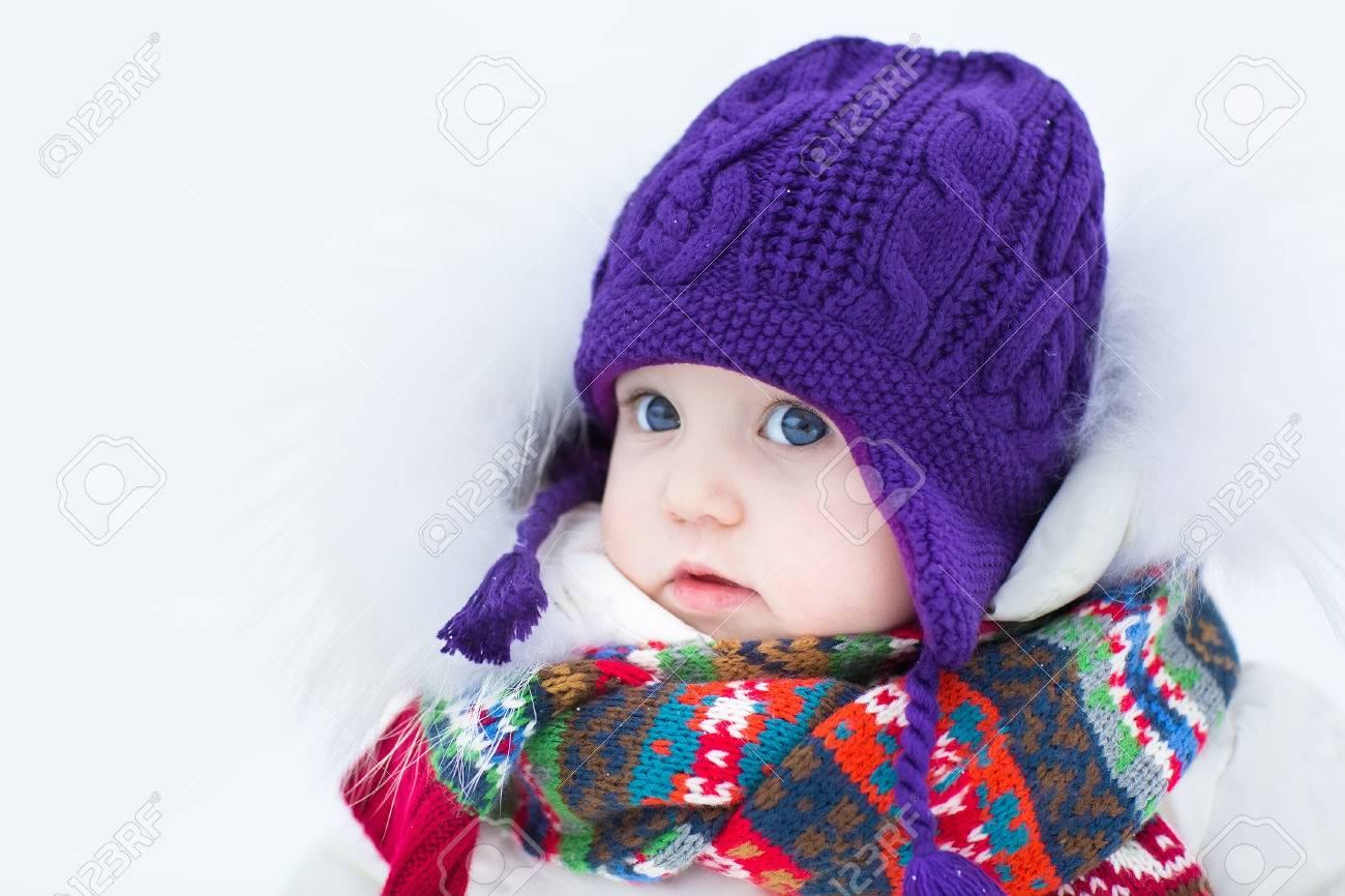 796e1da9a Cute Baby Girl Wearing A Warm Winter Hat And A Colorful Scarf ...