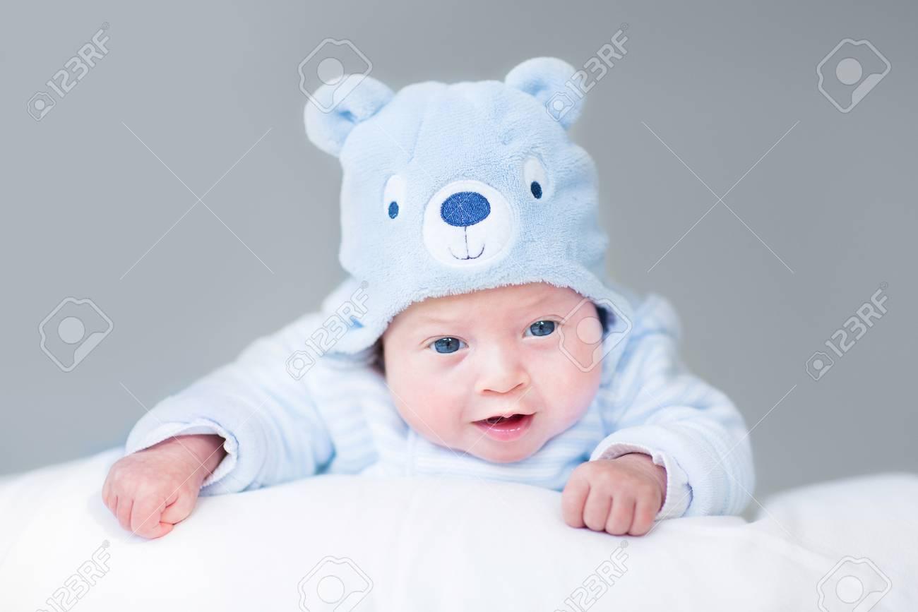 3d62b3af4e7 Portrait of a cute newborn baby boy in a teddy bear hat Stock Photo -  29889101