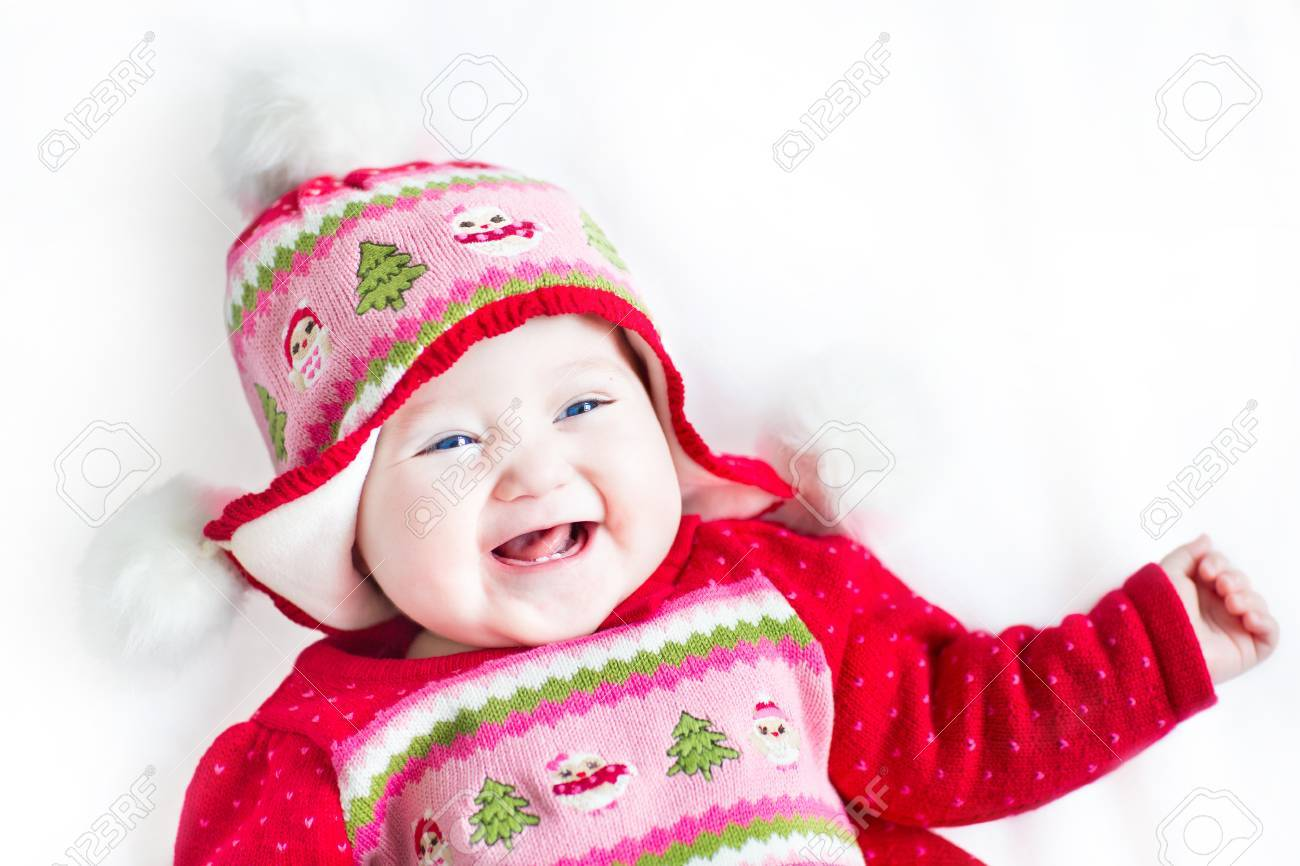 71191f71b Happy Laughing Baby Girl In A Red Dress With Christmas Ornament ...
