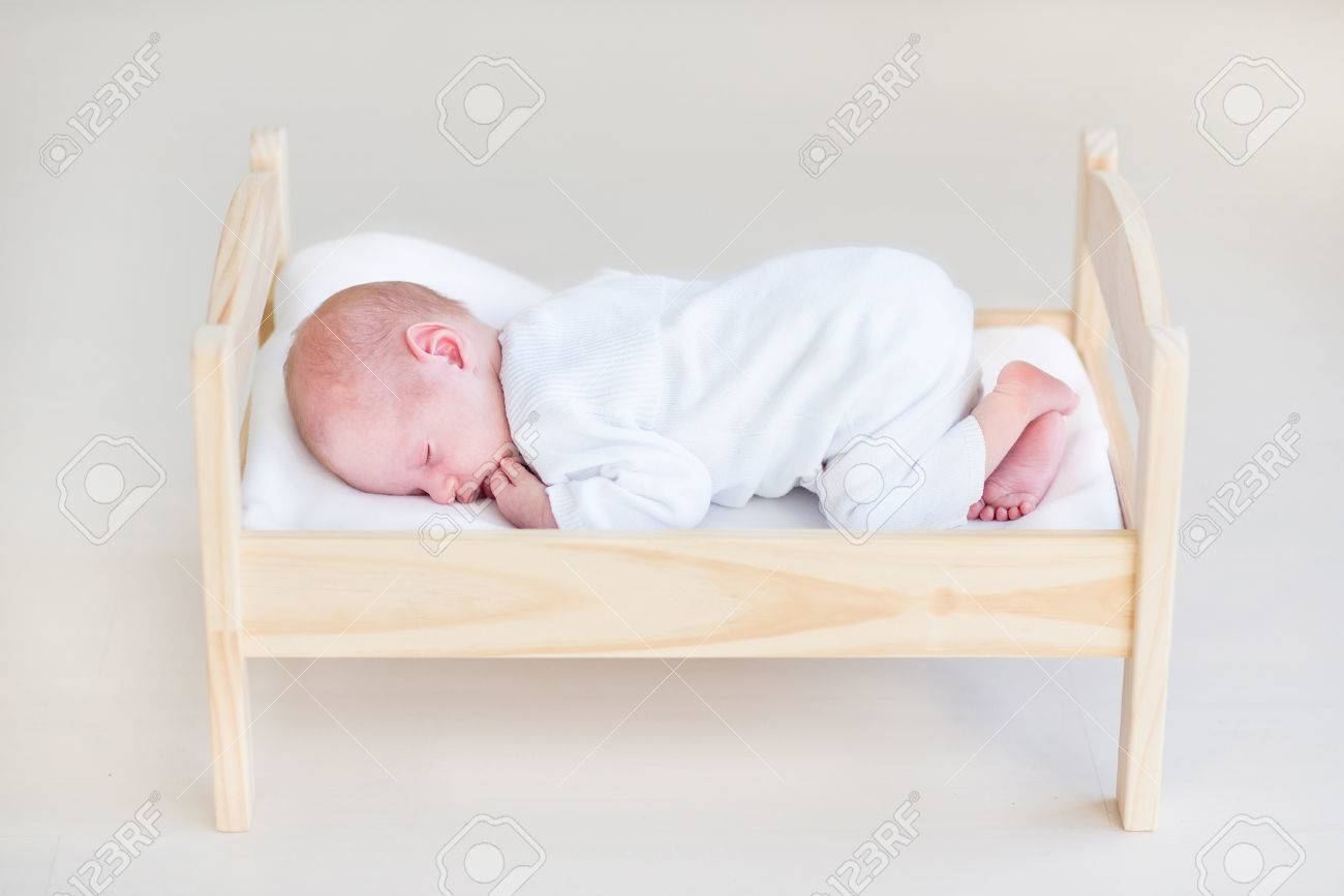 Baby bed newborn - Cute Sleeping Newborn Baby In A Toy Bed Stock Photo 29972628