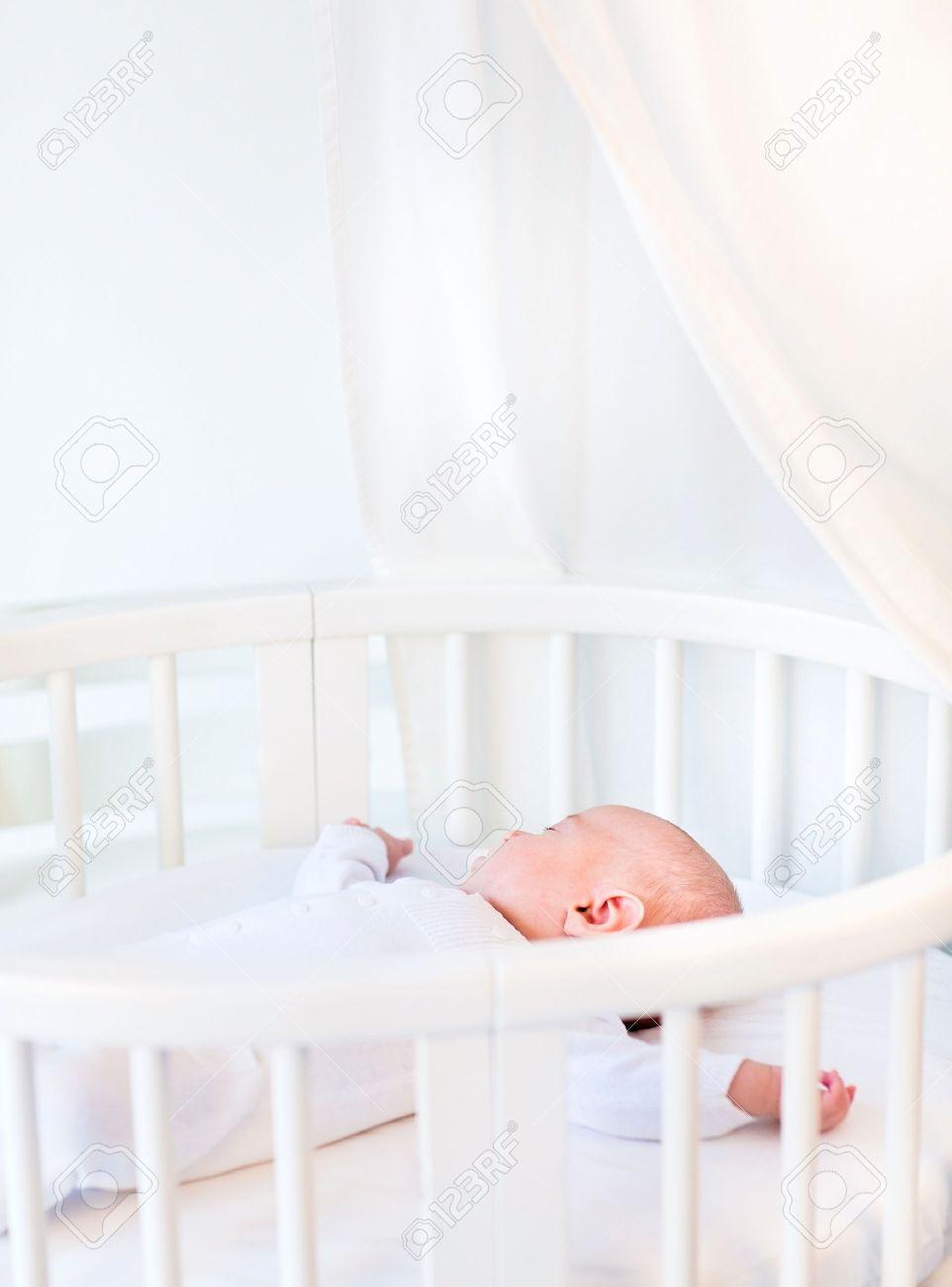 Portrait Of A Newborn Baby Boy Sleeping In A White Round Crib ...