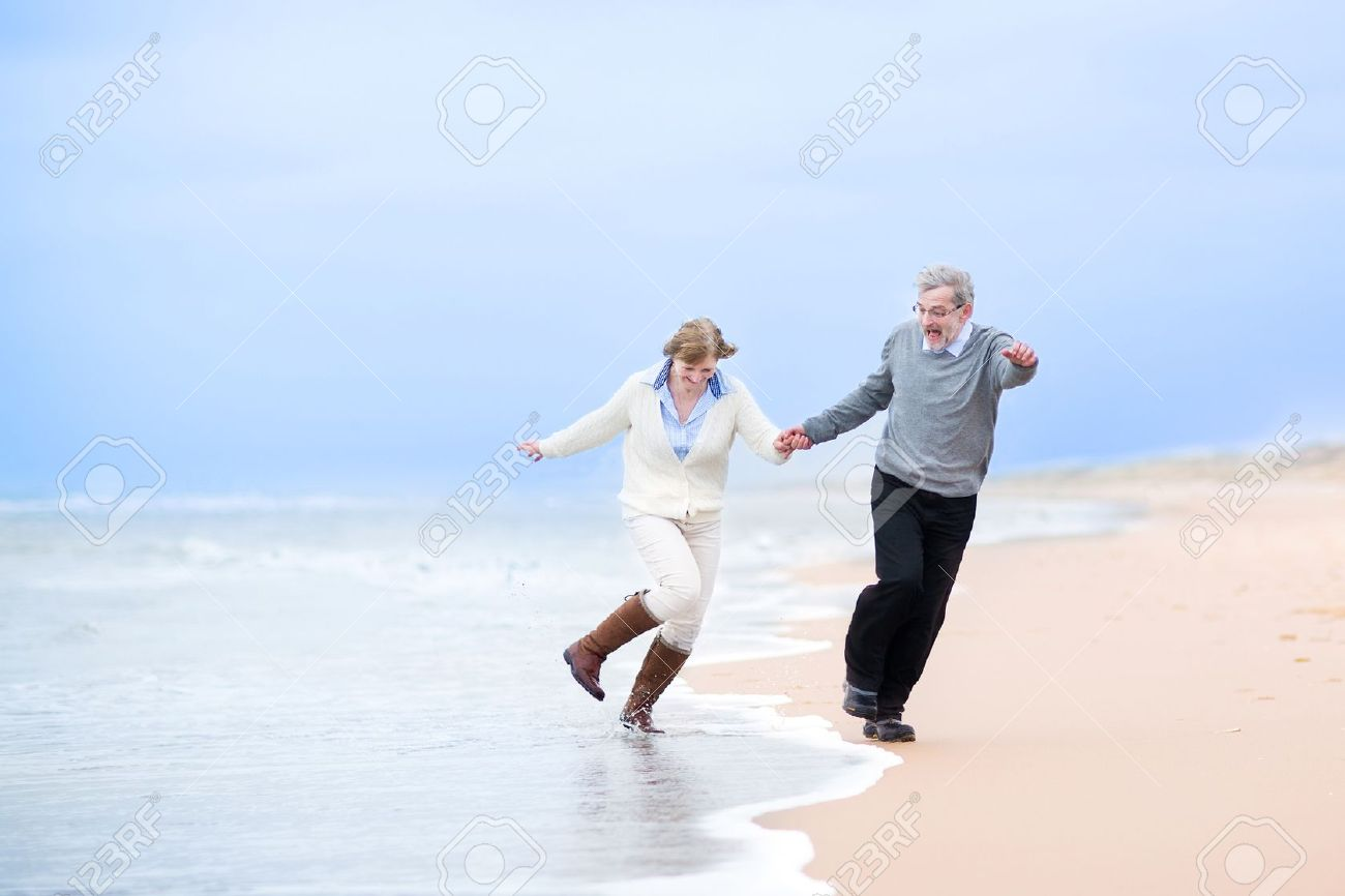 Couple Holding Hands Running Away
