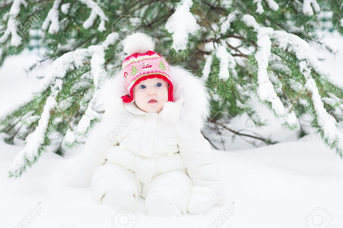 f59517a58c38 Beautiful Laughing Baby Girl Sitting Under A Christmas Tree Wearing ...