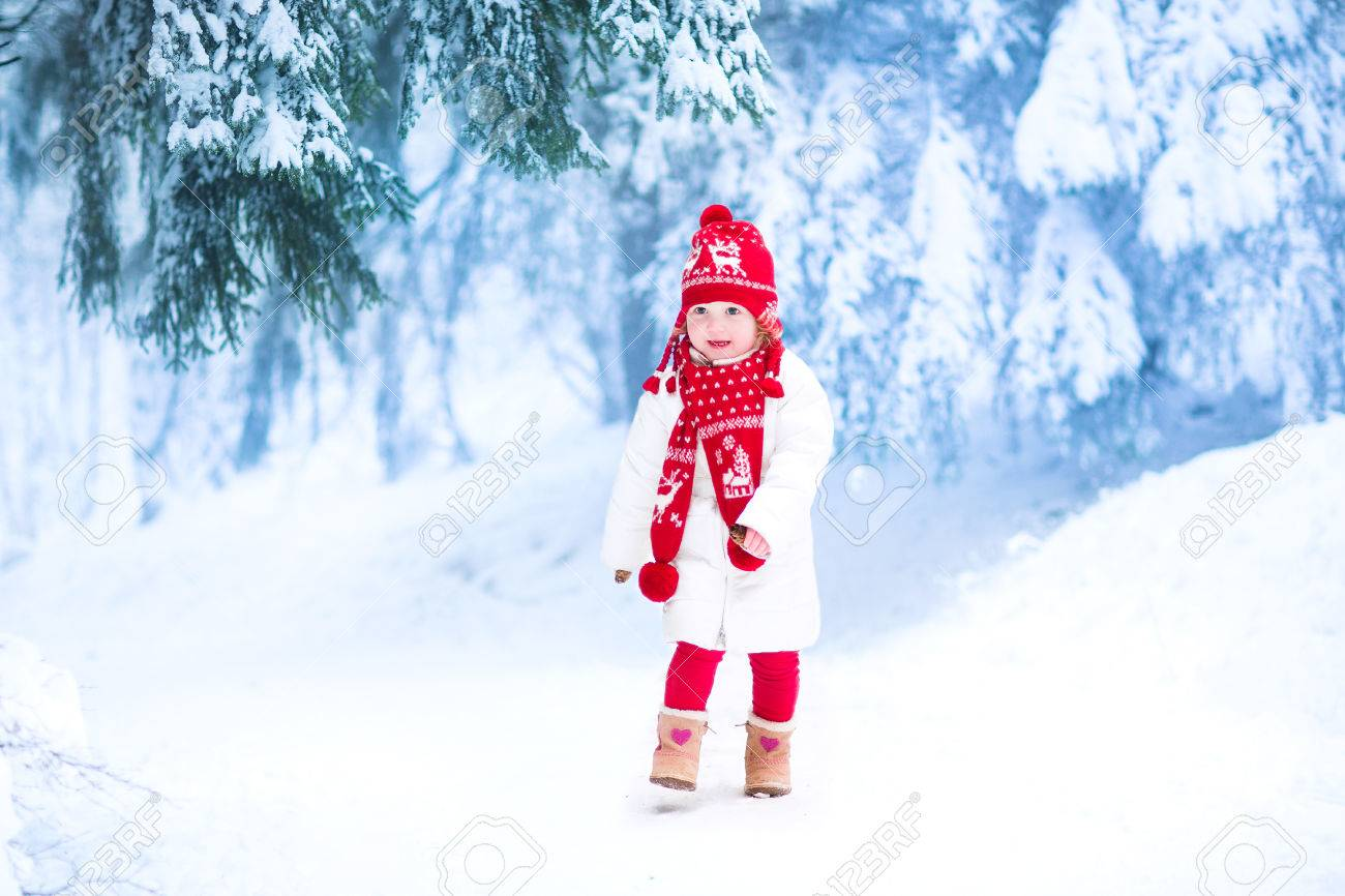 6038a2d8a Happy Laughing Toddler Girl Wearing A White Down Jacket And Red ...