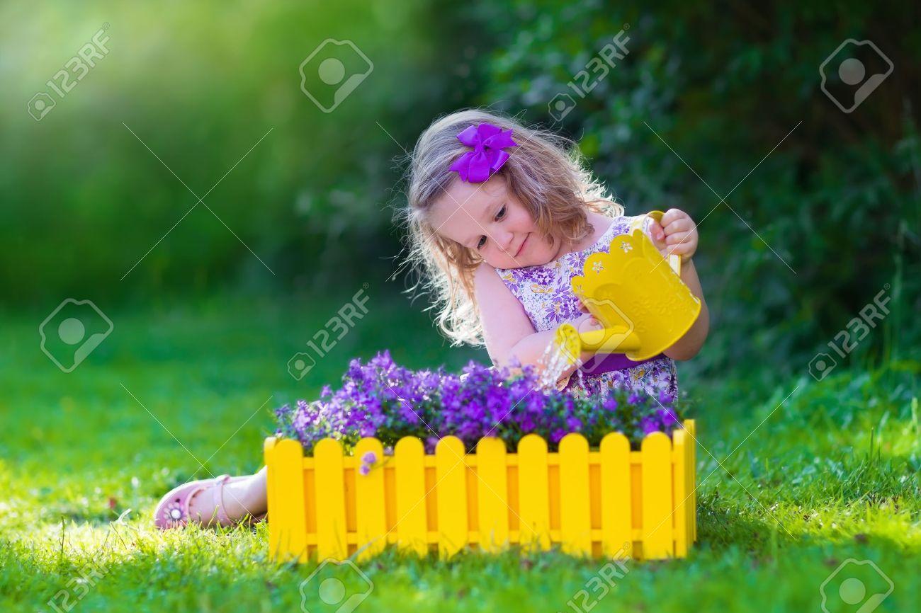 kids gardening children watering flowers little girl with
