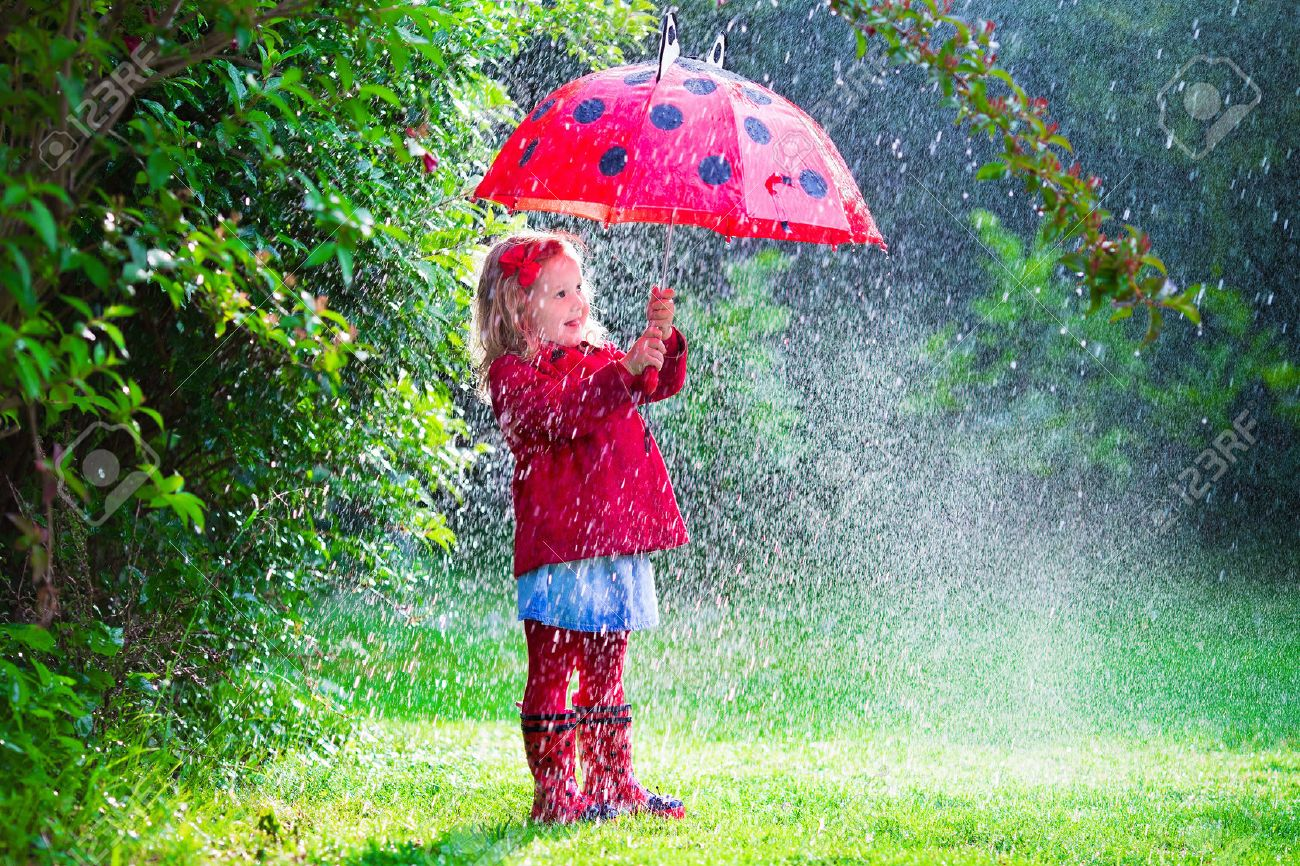Little Girl With Red Umbrella Playing In The Rain Kids Play Outdoors By Rainy Weather
