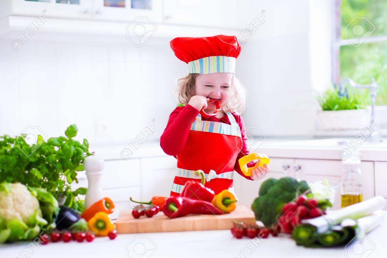 Kids Cooking Fresh Vegetable Salad In White Kitchen. Children ...