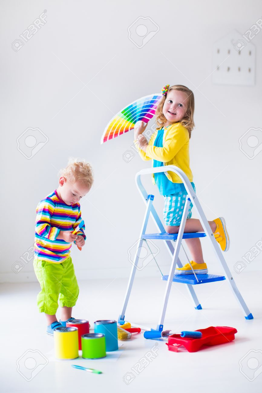 Family Remodeling House Home Remodel And Renovation Kids Painting Walls With Colorful Brush