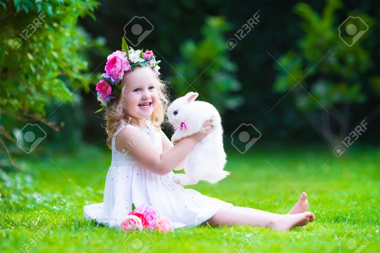 Little girl with real rabbit child playing with pet bunny kids little girl with real rabbit child playing with pet bunny kids play with animals children at easter egg hunt toddler kid in flower crown and white izmirmasajfo