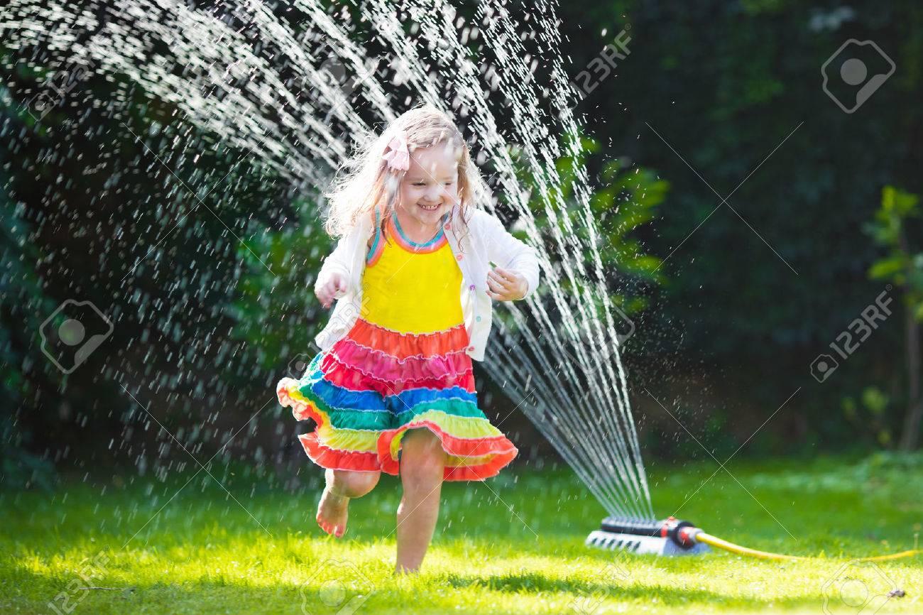 water sprinkler stock photos royalty free water sprinkler images
