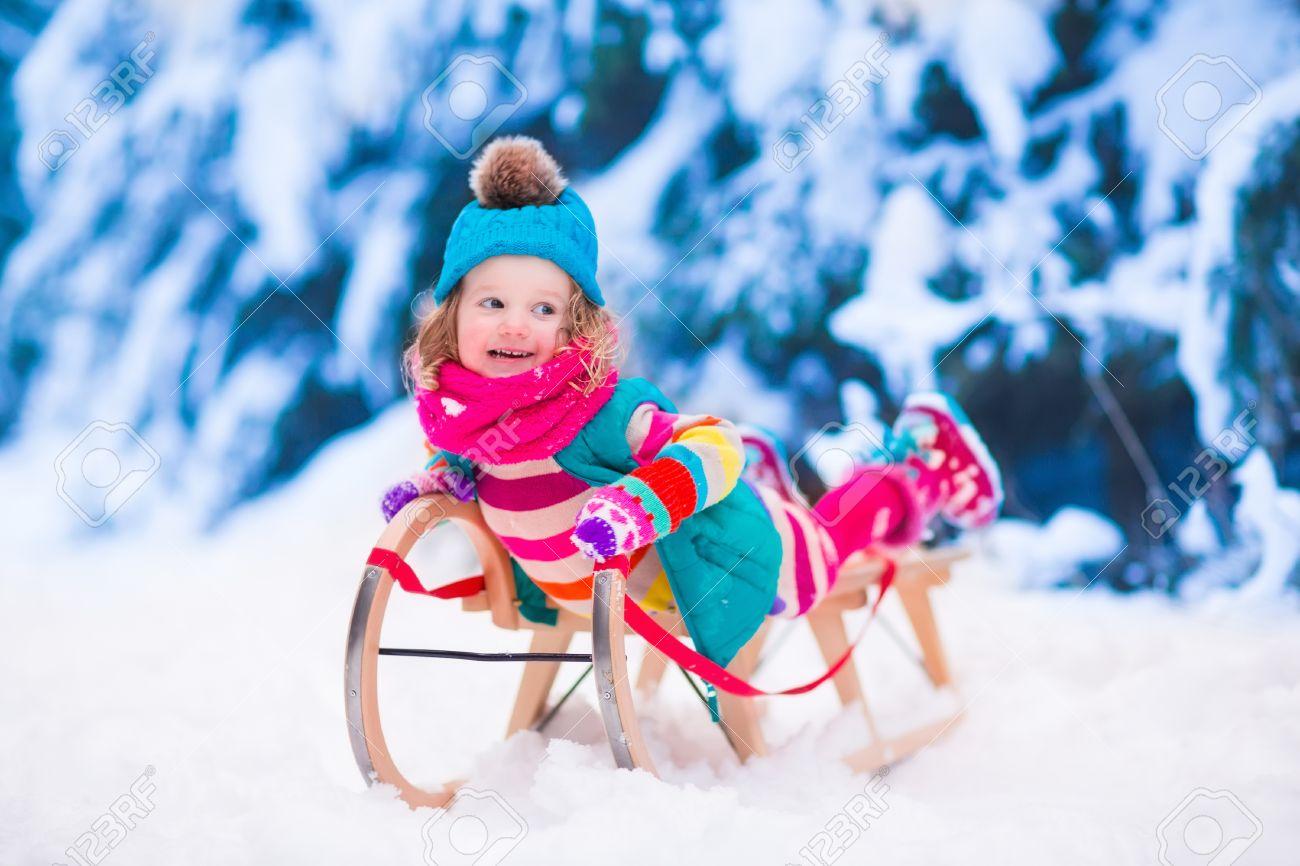 Christmas Vacation Sled.Little Girl Enjoying A Sleigh Ride Child Sledding Toddler Kid