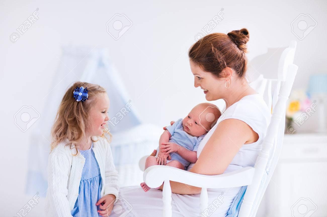 ac1af850cd760 Little sister hugging her newborn brother. Toddler kid meeting..
