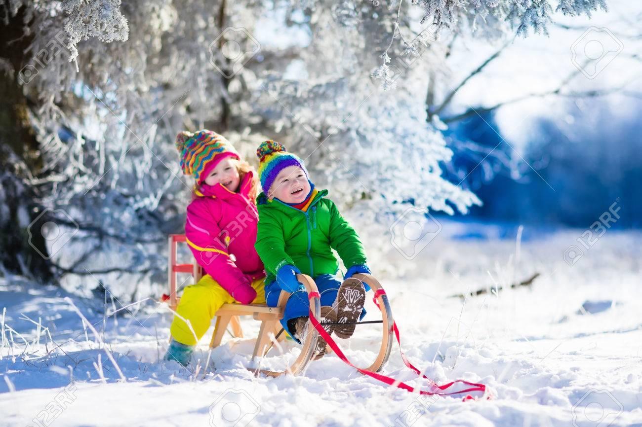 Christmas Vacation Sled.Little Girl And Boy Enjoying Sleigh Ride Child Sledding Toddler