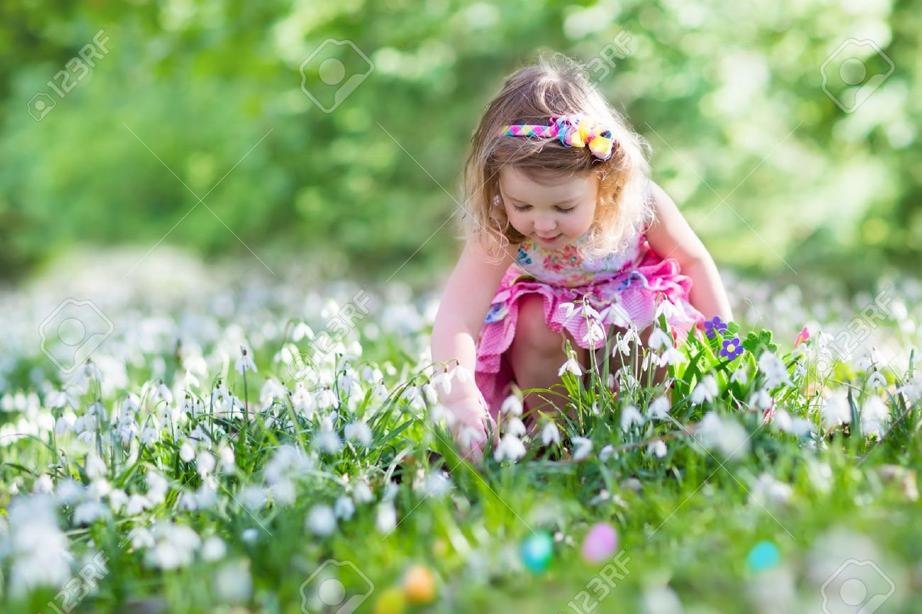 Little Girl Having Fun On Easter Egg Hunt Kids In Blooming Spring Stock Photo Picture And Royalty Free Image Image 51422063