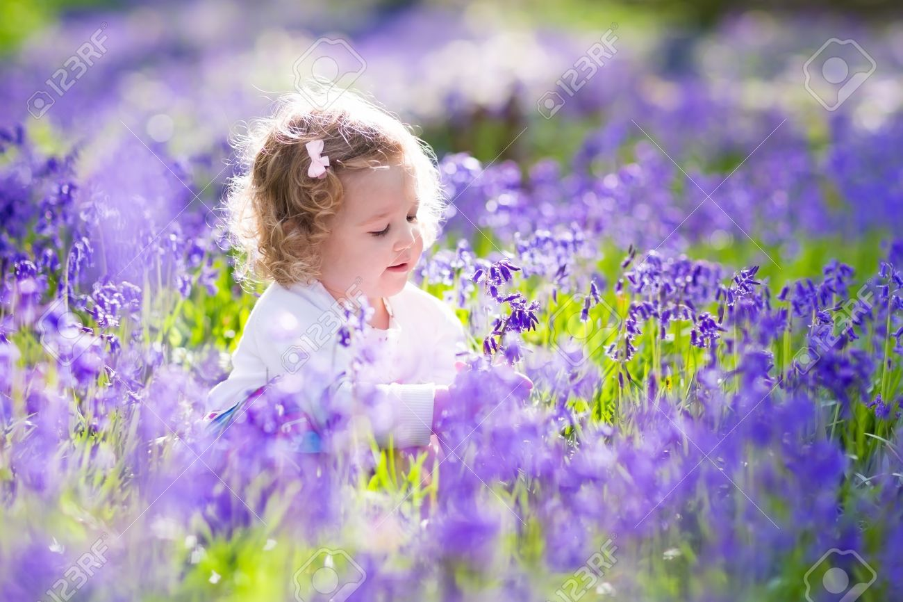 http://previews.123rf.com/images/famveldman/famveldman1602/famveldman160200210/52594617-Little-girl-playing-in-sunny-blooming-garden-Baby-on-Easter--Stock-Photo.jpg