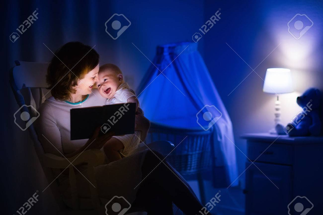 Bedroom at night time - Mother And Baby Reading A Book In Dark Bedroom Mom And Child Read Books Before
