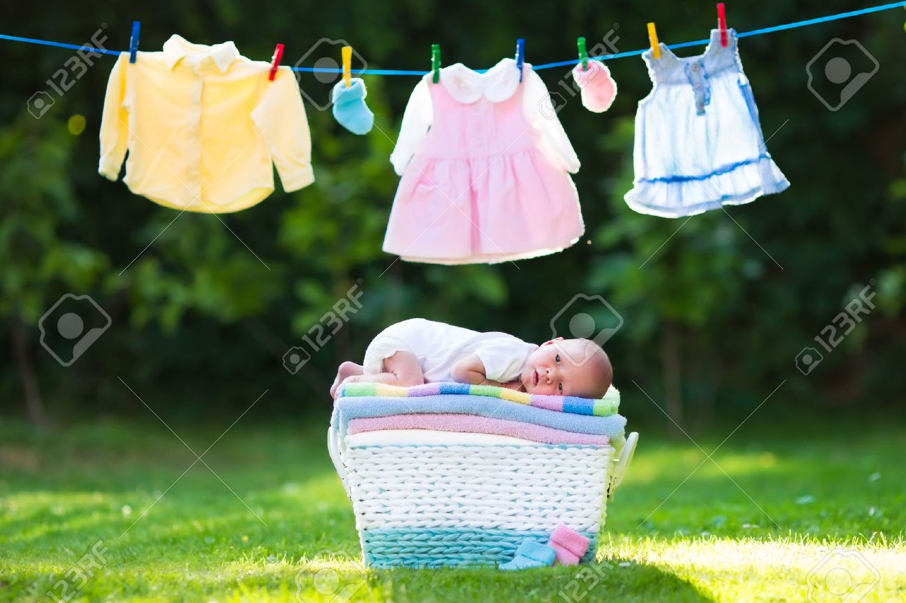edfa59133c99 Newborn Baby On A Pile Of Clean Dry Towels. New Born Child After ...