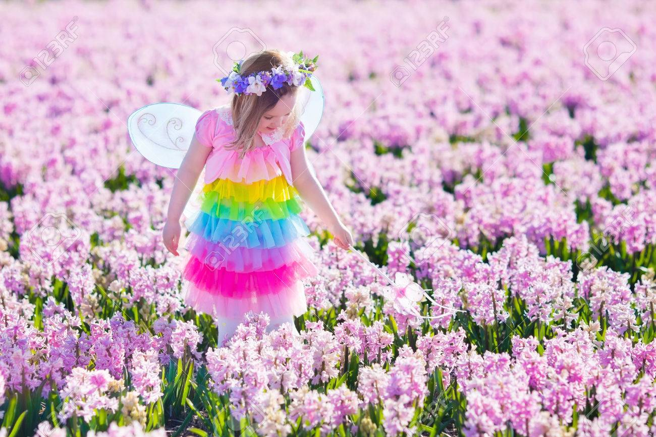Beautiful Girl Playing In Blooming Hyacinth Flower Field Kids