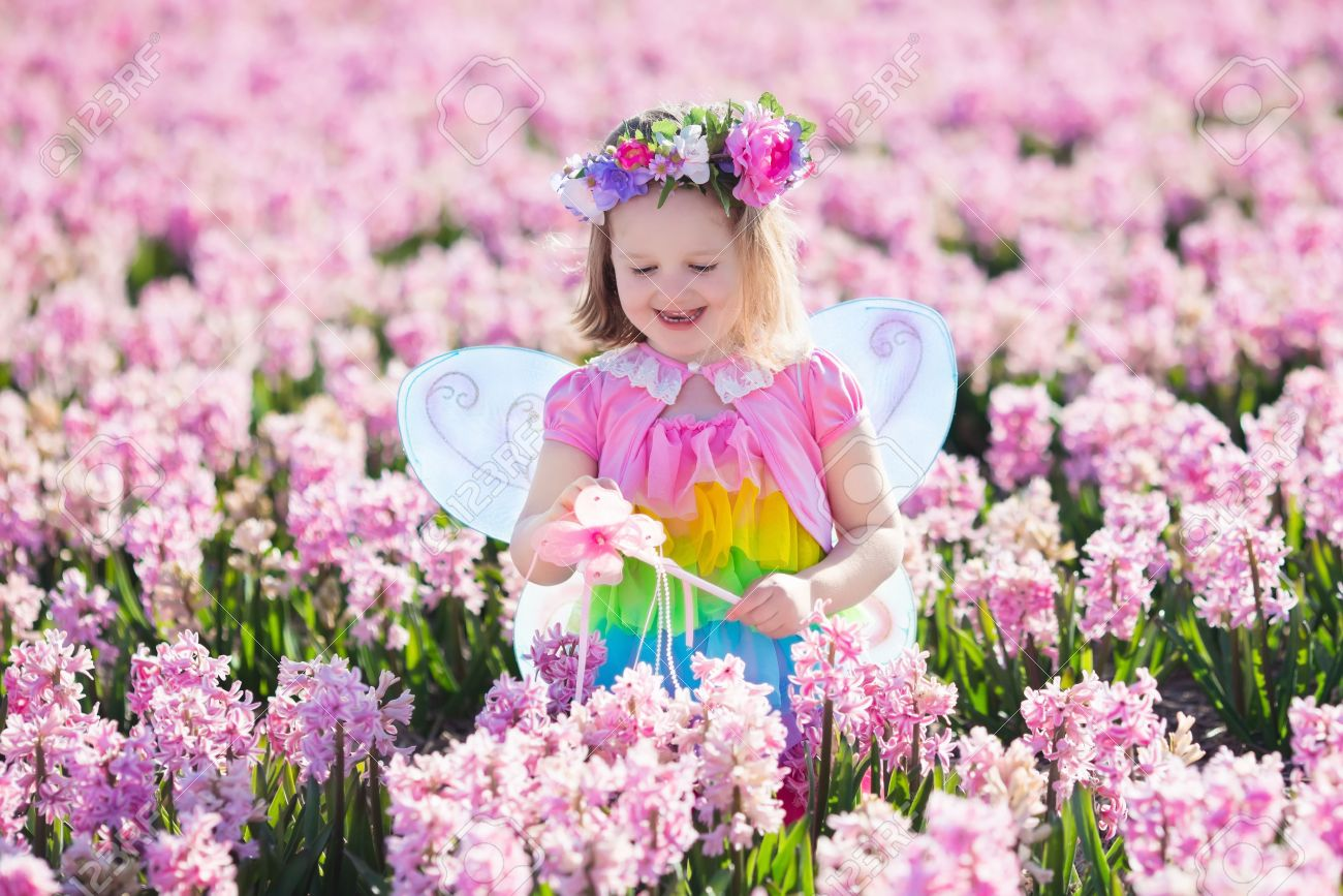 Awesome Beautiful Girl Playing In Blooming Hyacinth Flower Field. Kids Princess  Birthday Party With Fairy Costume