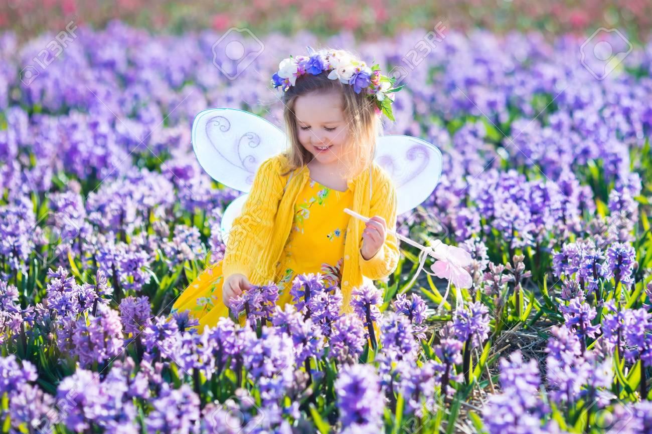 Beautiful Girl Playing In Blooming Hyacinth Flower Field Kids