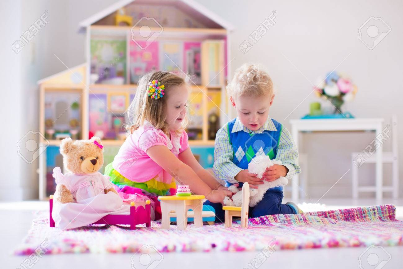 Vintage Smokey The Bear Teddy Bear, Kids Playing With Doll House And Stuffed Animal Toys Children Stock Photo Picture And Royalty Free Image Image 57560269