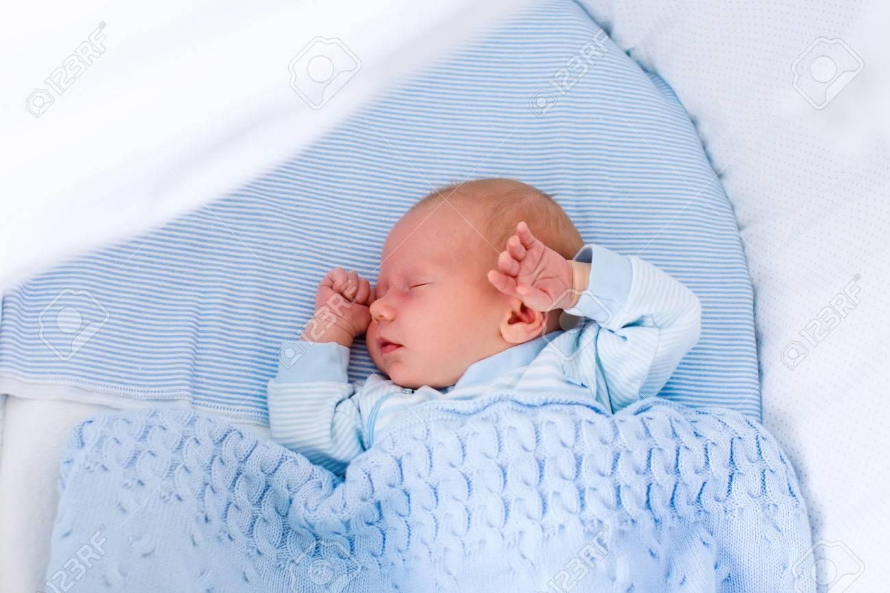 783cbc23c9ba Newborn Baby Boy In Bed. New Born Child Sleeping Under A Blue ...